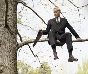 man saws branch